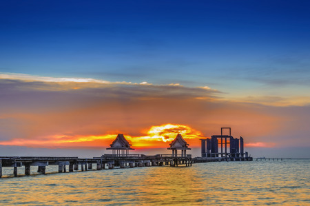 Landscape of Wooded bridge in the port and sunset.