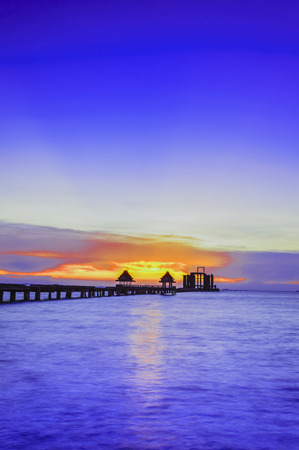 Landscape silhouette of Wooded bridge in the port between sunrise