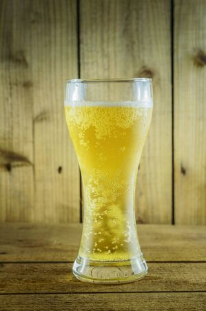 wooden floors: Beer in glass on wooden floors Stock Photo