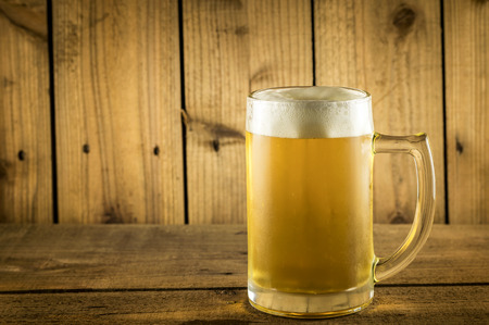 copyspace: Glass beer on wood background with copyspace