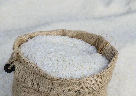 Close up Jasmine rice in burlap bag decorated.