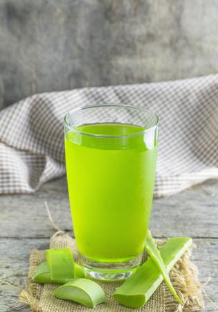 dropper: Glass of aloe vera juice for health. Stock Photo
