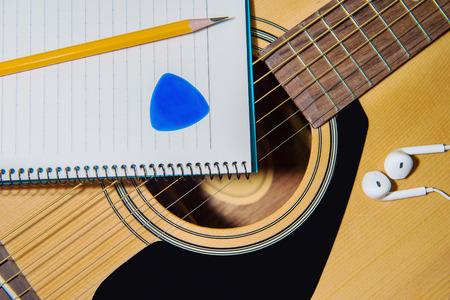 Guitar with pancil. photo