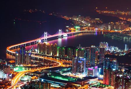 south korea: GwangAn Bridge and Haeundae at night in Busan,Korea