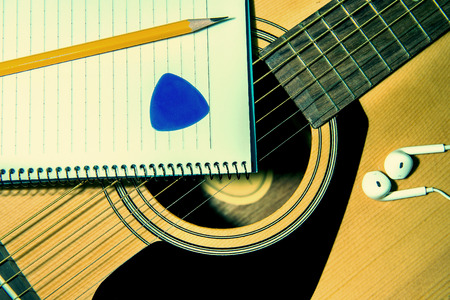 letter paper: Guitar with pancil. Stock Photo