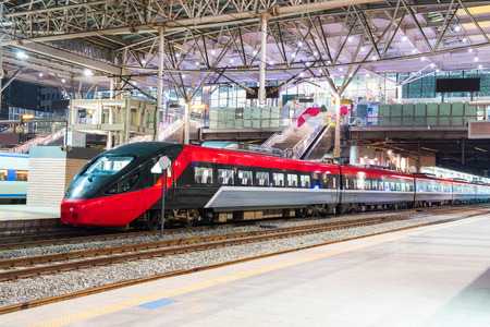 High speed train by the railway station Stockfoto