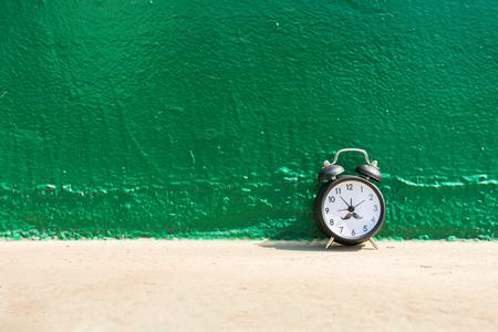 ten empty: Alarm clock on green background