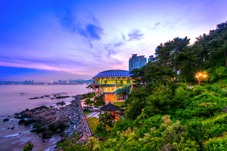 Dongbaek island with Nurimaru APEC House and Gwangan bridge at sunset in Busan,South Korea