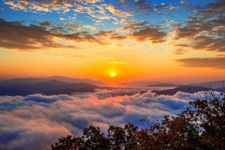 fog: Seoraksan mountains is covered by morning fog and sunrise in Seoul,Korea Stock Photo