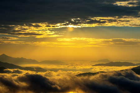 fall sunrise: Seoraksan mountains is covered by morning fog and sunrise in Seoul,Korea Stock Photo