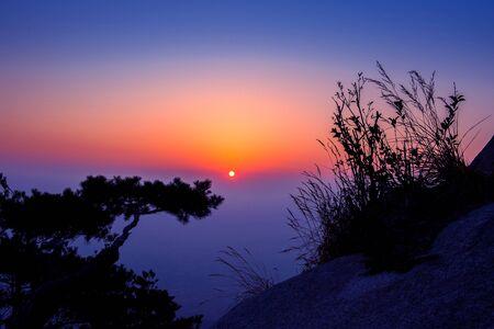 faintly visible: Sunrise on Bukhansan mountains in Seoul, Korea.