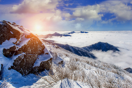 Seoraksan mountains is covered by morning fog and sunlight in winter, Korea.