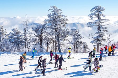DEOGYUSAN,KOREA - JANUARY 23: Tourists taking photos of the beautiful scenery and skiing around Deogyusan,South Korea on January 23, 2015.