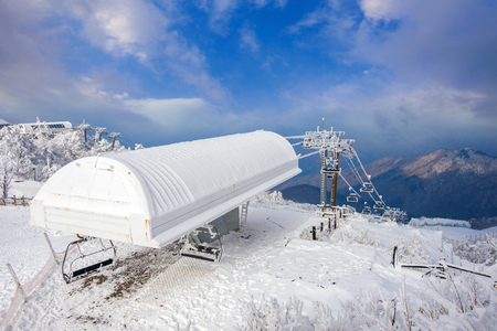 wintersport: Ski chair lift is covered by snow in winter,Deogyusan mountains in South Korea.