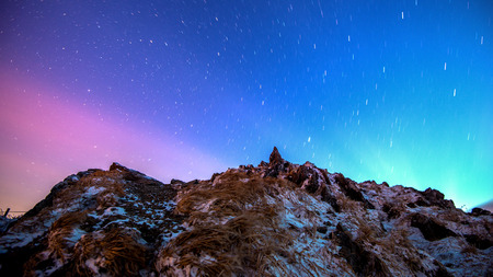 magnetosphere: Star trails over the winter mountains landscape. Stock Photo
