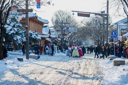 snowlandscape: JEONJU, SOUTH KOREA - JAN 24: Jeonju traditional Korean village,Traditional Korean style architecture and Tourists in Jeonju traditional Korean village on Jan 24, 2016 in Jeonju, South Korea. Editorial