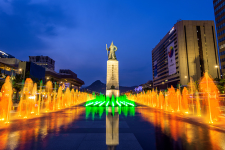 SEOUL, SOUTH KOREA - APRIL 30, 2016:Beautifully color water fountain at Gwanghwamun Plaza with the statue of the Admiral Yi Sun-sin in downtown.Photo taken on April 30,2016 in seoul,South Korea. Editorial