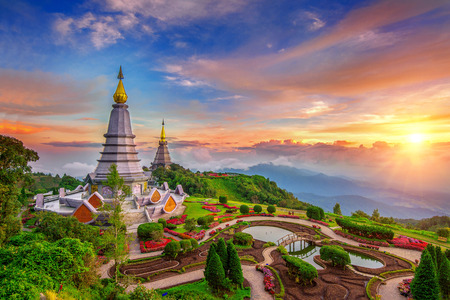 The best of landscape in Chiang Mai. Pagodas Noppamethanedol & Noppapol Phumsiri at sunset in Inthanon mountain, Thailand. Фото со стока