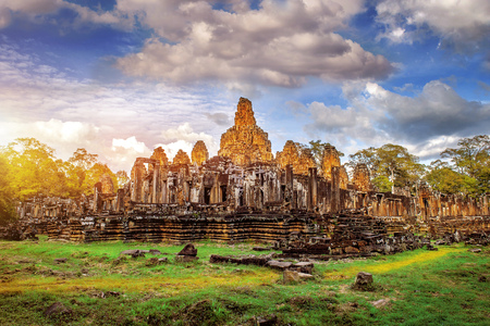 Ancient stone faces of Bayon temple, Angkor Wat, Siam Reap, Cambodia.