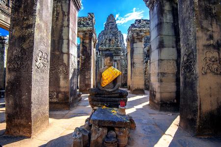Ancient stone faces of Bayon temple, Angkor Wat, Siam Reap, Cambodia.