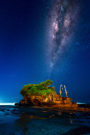 Milky way over Tanah Lot Temple at night in Bali, Indonesia.(Dark)