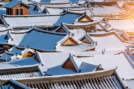 snowlandscape: Roof of Jeonju traditional Korean village covered with snow, Jeonju Hanok village in winter, South Korea.