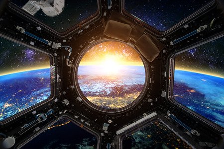 orbiting: Earth and Spacecraft. Elements of this image furnished by NASA.