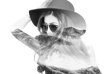 Double exposure portrait of beautiful girl combined with photograph of snowy mountain