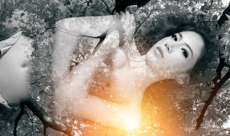 combined: Double exposure portrait of Beautiful girl combined with photograph of nature.