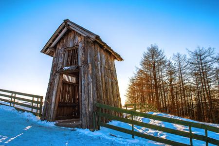 snowy field: Wooden cottage in winter. Daegwallyeong Sheep Farm in Gangwondo, South Korea.