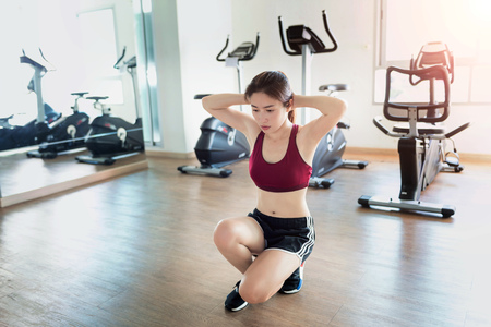 Young fitness woman executed exercise in gym.