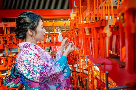 Kyoto,Japan- 17 November 2017: Women in traditional japanese kimonos at Fushimi Inari Shrine in Kyoto, Japan
