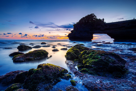 Tanah Lot Temple at sunset in Bali, Indonesia.(Dark)Seascape.