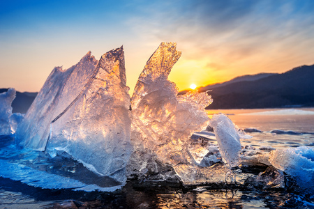 Very large and beautiful chunk of Ice at Sunrise in winter.