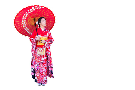 Asian woman wearing japanese traditional kimono on white background.