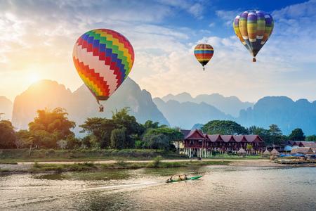 Hot air balloon over Nam Song river at sunset in Vang vieng, Laos. 스톡 콘텐츠
