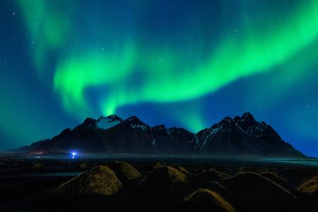 Northern Light, Aurora borealis at Vestrahorn mountains in Stokksnes, Iceland.