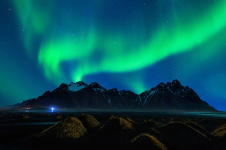 Northern Light, Aurora borealis at Vestrahorn mountains in Stokksnes, Iceland. Standard-Bild - 98921330