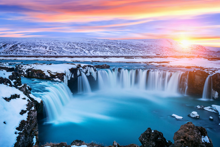 Godafoss waterfall at sunset in winter, Iceland.
