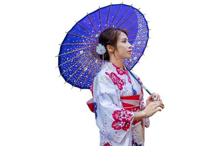 Asian woman wearing japanese traditional kimono with umbrella on white background. Stok Fotoğraf