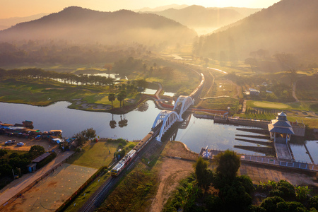 Aerial of Thachomphu Railway Bridge or White Bridge in Lamphun, Thailand. 免版税图像