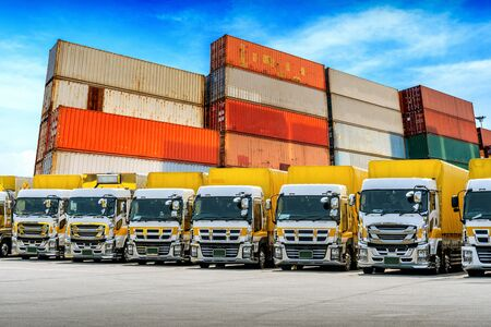 Row of Cargo vehicles and containers. Freight transportation. Cargo truck park. Banco de Imagens