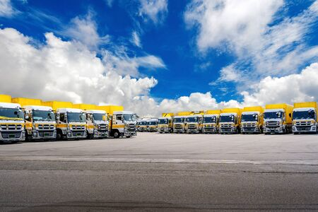 Row of Cargo vehicles. Freight transportation. Cargo truck park. Stock fotó