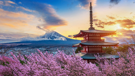 Beautiful landmark of Fuji mountain and Chureito Pagoda with cherry blossoms at sunset, Japan. Spring in Japan. Editorial
