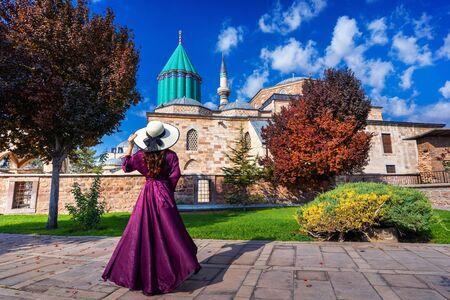 Beautiful girl walking at mosque in Konya, Turkey.