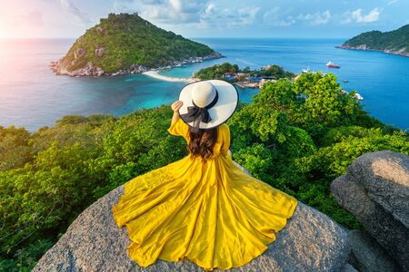 Beautiful girl sitting on viewpoint at Koh Nangyuan island near Koh Tao island, Surat Thaini in Thailand.