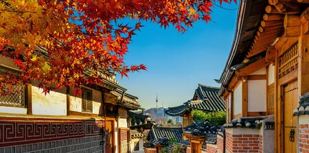 Autumn seasons at Bukchon Hanok Village. Traditional Korean style architecture in Seoul,Korea. 写真素材