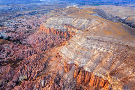 Aerial view of beautiful mountains and Red valley in Goreme, Cappadocia in Turkey.