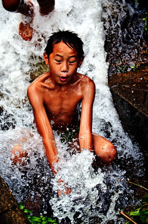 Stock Photo - Doi Suthep temple Chiang Mai, Thailand ,photo of child play stream water on the mountain.