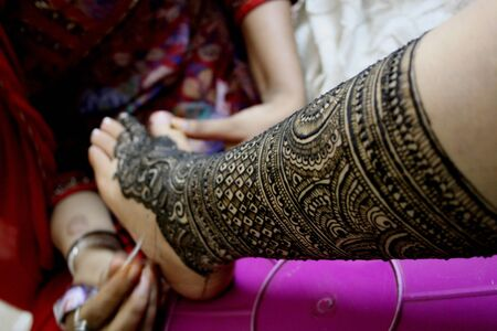 Traditional Indian Bride, henna painting photo